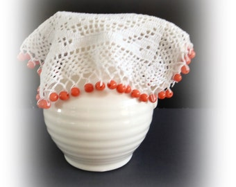 Vintage crochet jug cover with orange beads