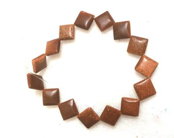 Glimmering goldstone square beads / 8 inch strand / 10 X 10 mm
