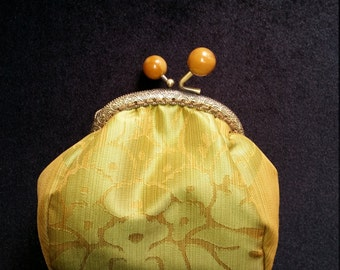 L510.    Coin purse in rich green gold fabric.