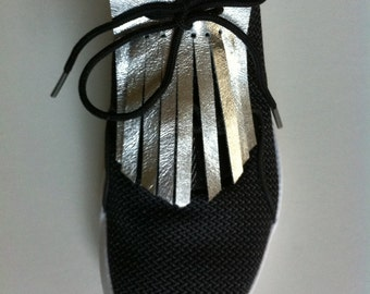 Pair of fringed leather fashion shoes with laces