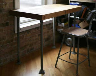 vintage butcher block table with steel pipe legs