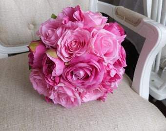 Bright pink silk wedding bouquet. Made with artificial peonies and roses.