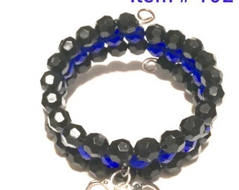 Blue line memory wire beaded bracelet with handcuffs charm