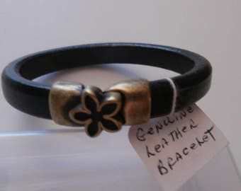 Sale - Genuine black leather bracelet with an antique bronze ornamental flower and clasp