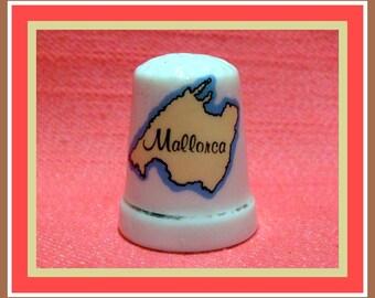 Vintage thimble of white ceramic Mallorca theme.