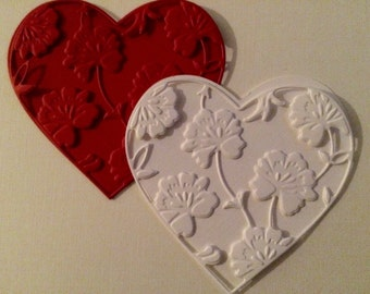 "Heart of my hearts.  Eight 3"" hearts.  Four plain and four floral embossed."