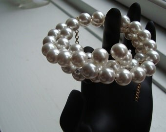 SOLD Bracelets swarowski crystal pearls on memory wire.  Pearls on the end of bracelets .