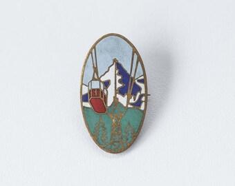 Vintage pin with skyrail, gold toned pin, makred pin, retro champion pin