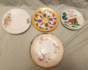 4 misc saucers/plates for display
