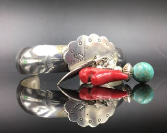 Sterling silver vintage cuff Natvie American design with feather, coral bear and turquoise dangling charms.  Artist signed.