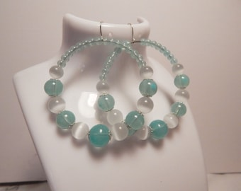 Hoop Earrings, with pale blue glass beads....