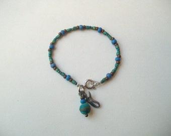 Glass bead bracelet, seed bead bracelet, goddess charm bracelet, stacking bracelet, cool earth tones, beaded bracelet, blue and green