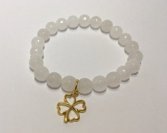 Semi precious stones bracelet, milky white faceted jade (8 mm) and gold plated silver clover pendant
