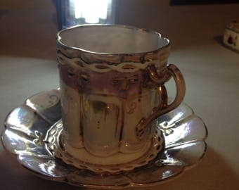 Vintage pale cream, purple and gold cup and saucer