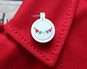 Mini embroidery Hoop brooch with colorful pennants flags.
