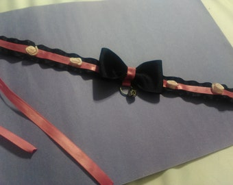 Pink and black collar