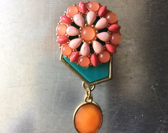 teal, pink and orange flower decorative magnet