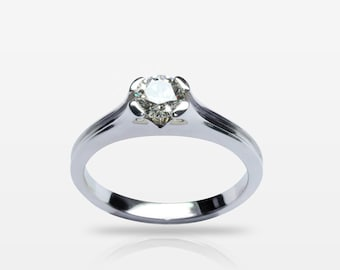 Solitaire diamond engagement ring in 18kt white gold. Certified natural diamond 0.40ct.