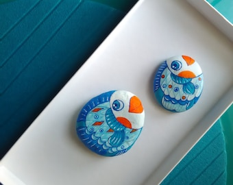 Two hand-painted stones with cute little fishes