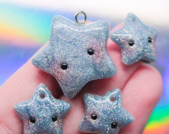 Holo star charm and dust plug charms