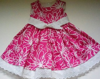 Pink floral dress with white eyelet trim