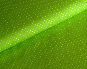 Green cotton fabric with white dots