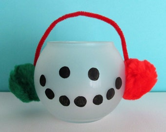 Hand-Painted Frosted Glass Snowman Candleholder, featuring Ear Muffs