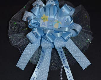 It's a boy---- pin corsage .