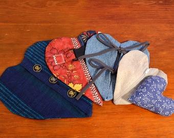 "Blue ""heartoshka"" - Heart-shaped cushion for fine motor skills - Button, zipper, shoelace... - Recycling - Upcycling - Handmade in Iceland"