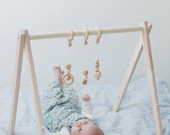 Disassembled wooden baby gym, no hangers, only frame + three wooden rings