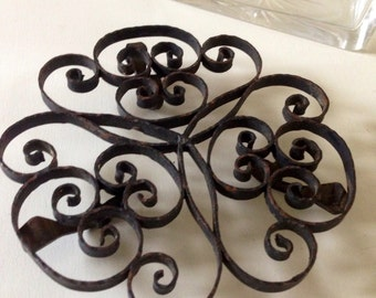 Small below flat vintage volutes in wrought iron