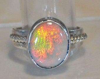 Sterling silver ring with opal setting