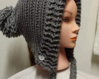 Earflap slouchy hat with braids and pom pom