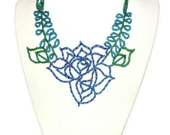 Statement necklace beaded rose flower, glass seed beads, purple blue petals, buds and leaf design, silver clasp, exquisite lotus eye catcher