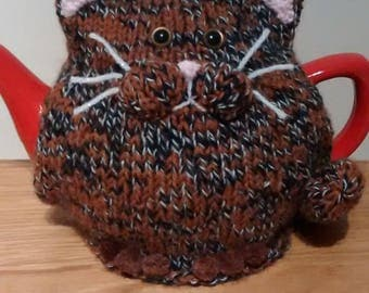 Hand-knitted tortoiseshell cat tea cosy