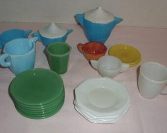Vintage Akro Agate Dishes. Seven Jadeite Plates.  Four White Saucers.  Blue Sugar, Creamer, Pitcher.  Slag. Jadeite. White. Blue. Yellow.