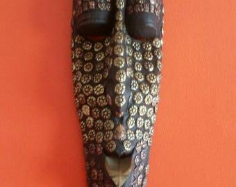 Hand carved vintage decorated hanging wall Masks ceremony symbols.