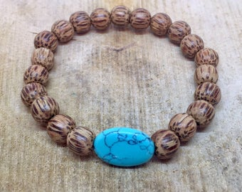 Coconut wooden bracelet with cabuchon tukooisen