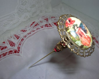 This hat pin in the Vintage style has a pretty fairy on a cabochon