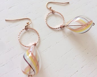 Pink gold earrings and blown glass