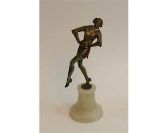 An Art Deco Lorenzl style bronze of a dancing maiden on onyx base, 23cm