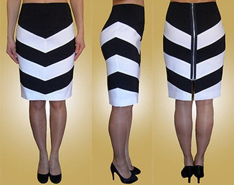 Stripy, navy, ivory, white, blue pencil skirt, zip fastening at the back. Sizes UK 8, 10, 12 / US 4, 6, 8