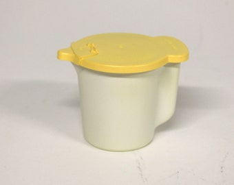 Vintage Tupperware jug with lid-Retro kitchen-Pastel yellow