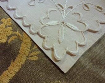 An old towel in hand, old linen embroidered linen