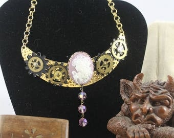 Pink cameo steampunk necklace with antique gears