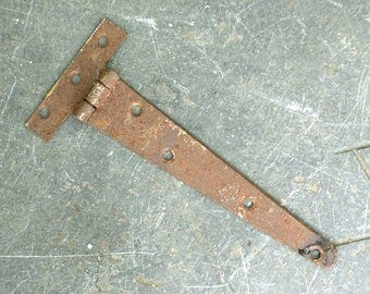 Vintage iron strap hinge, salvaged rusty, for farmyard shed barn stable door garden gate. Reclaimed antique ironwork industrial hardware