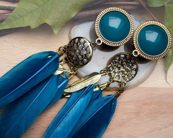 Plugs in antique bronze with a turquoise blue glass block and spring supporters (18-32 mm)