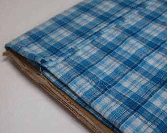 Turquoise blue and white check seersucker lightweight fabric - ideal for shirting and dressmaking