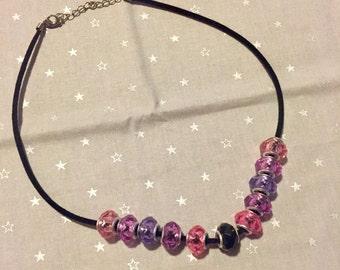Purple/pink/black beaded necklace