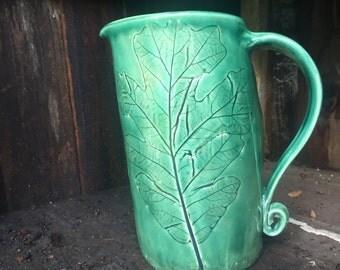Oak leaf impression stoneware pitcher